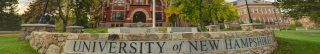 photo of university of new hampshire sign and main buildings