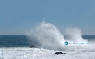 cover photo for northeast ocean plan showing ocean spray and rocks